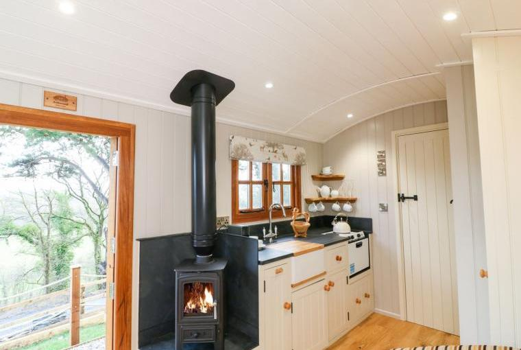 Warming woodburner and kitchen area