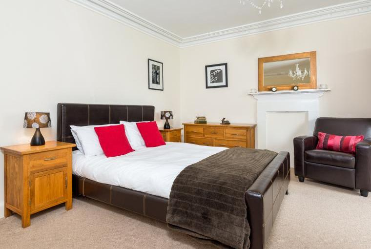 Internal image of the master bedroom with kingsize bed and ensuite