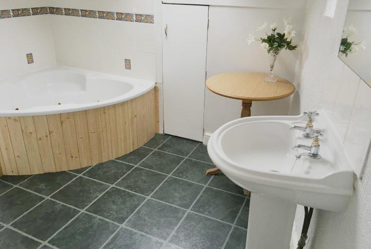 Bathroom with corner spa bath