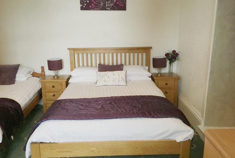 Downstairs triple bedroom with en suite