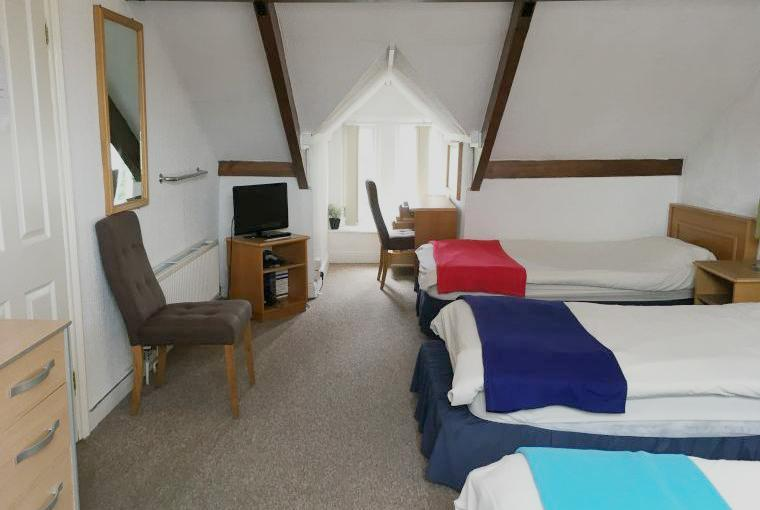 Bedroom with five single beds