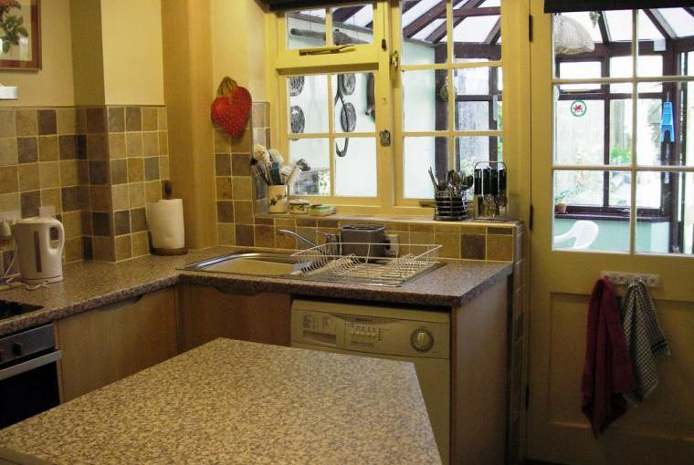 Kitchen looking through to conservatory