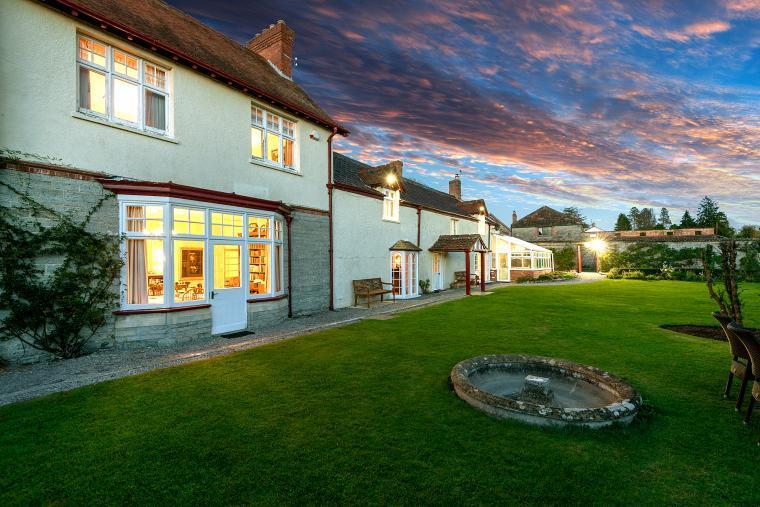 Cossington Park House at dusk - Coach House and Park Cottage behind