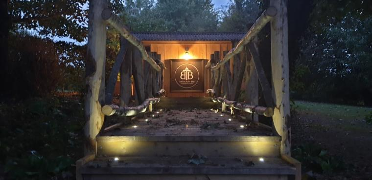 treatment studio lit up woods