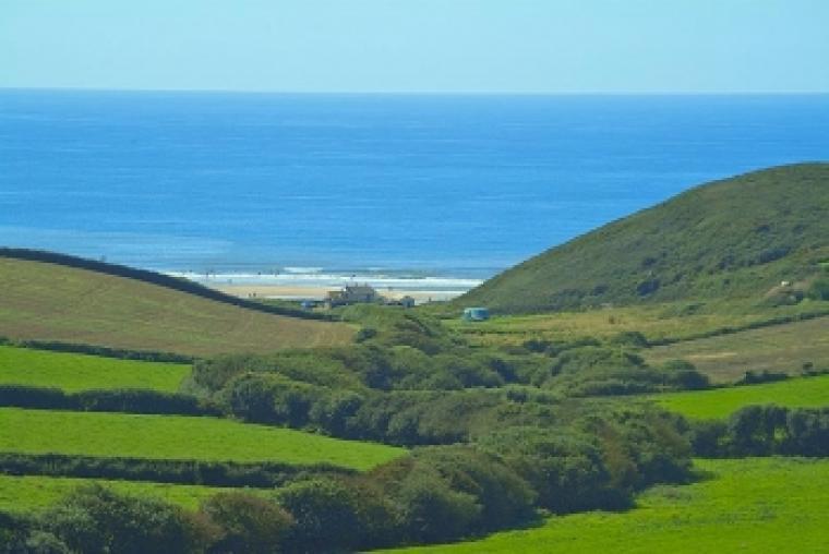 View across Farmland down to the sea