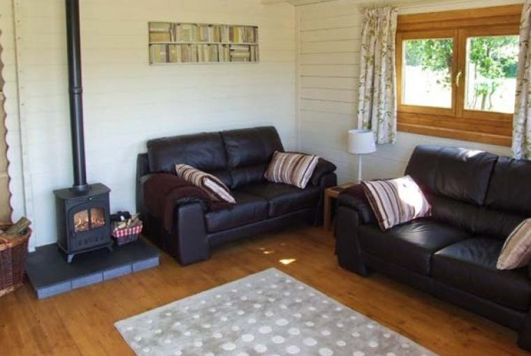 Comfy lounge area with woodburner