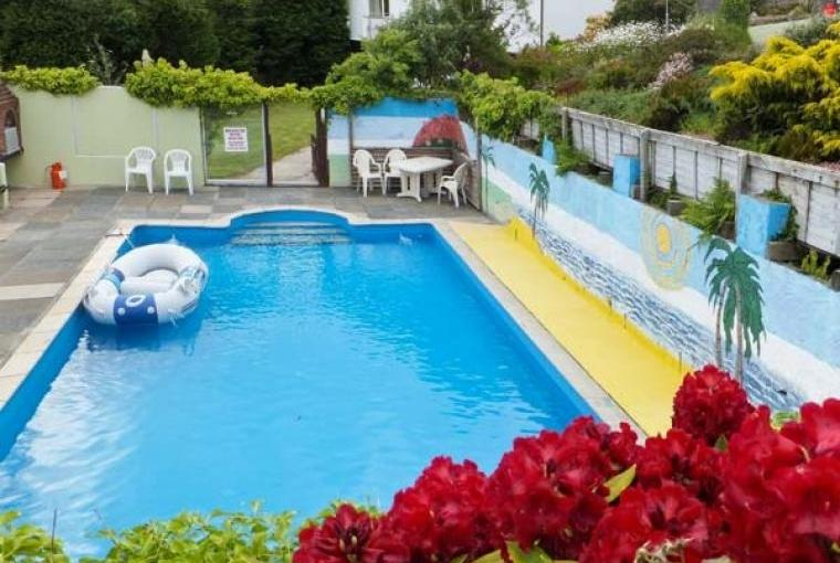 Shared outdoor solar heated swimming pool