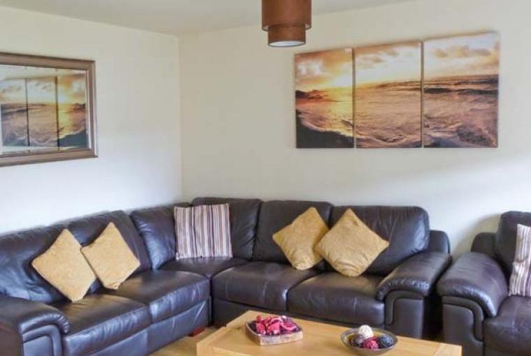 Stylish lounge at Maris Cottage