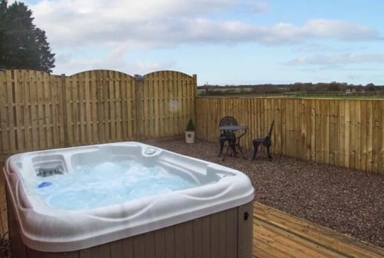 Warm bubbly hot tub for relaxing holidays
