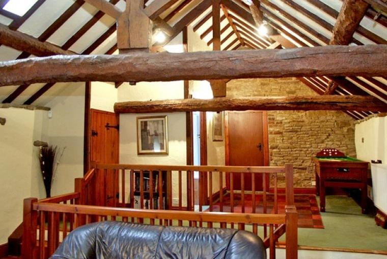 Beautiful beams in the Loft Country Cottage