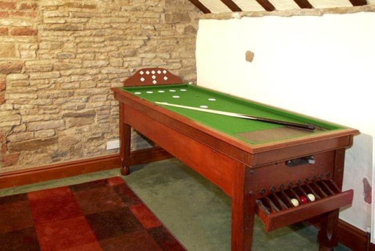 Games area with bar billiard table