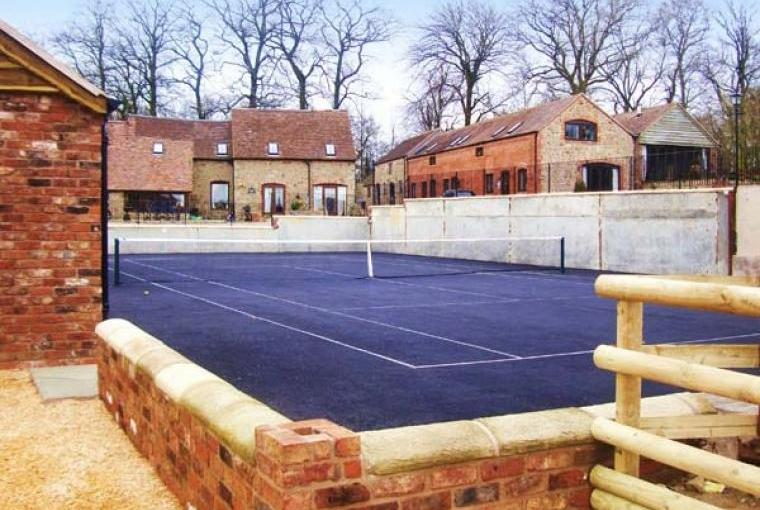 Full-size tennis court on site