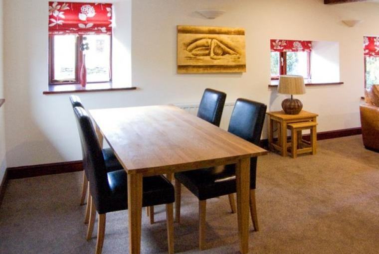 Dining area at Woodside Barn Family Cottage