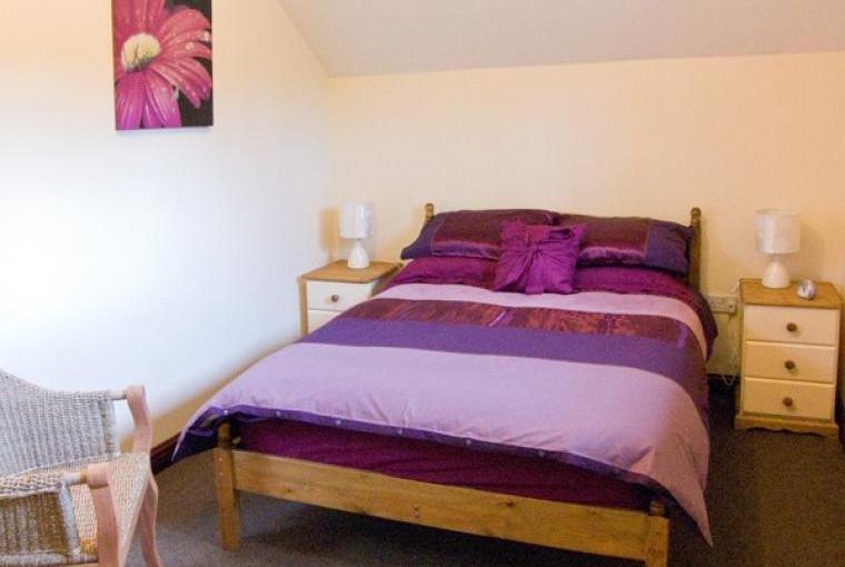 Comfy bedrooms at Woodside Barn Family Cottage