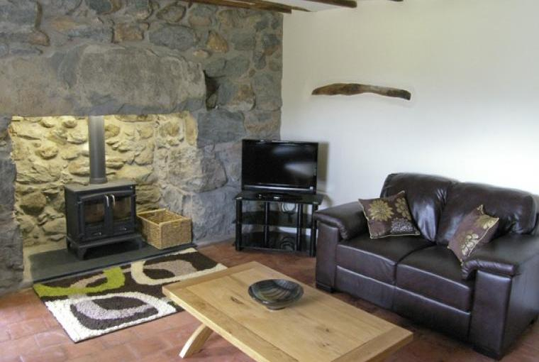 Lounge with woodburner at Ty Mawr Farmhouse