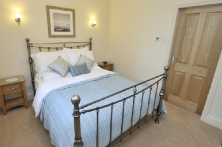 One of two double en-suite bedrooms with five foot wide comfy bed in each.