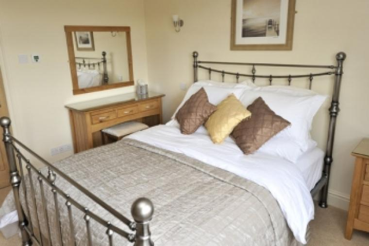 One of two double en-suite bedrooms with five foot comfy bed