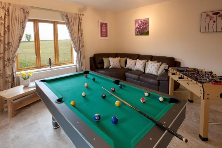 Games room with pool and table football and extra tv