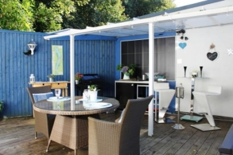 Al-fresco kitchen under cover with BBQ, induction hob, microwave, fridge & bar area