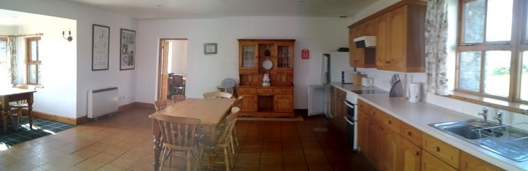 Large Kitchen with 2 dining tables, 10 chairs, this picture shows just one dining table.