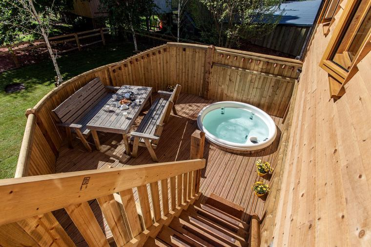 The Hot Tub Is Set Into The Deck Of The Apple Tree House