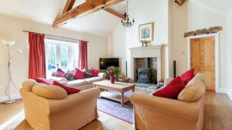 Riverside House Large lounge with log burner and vaulted ceiling