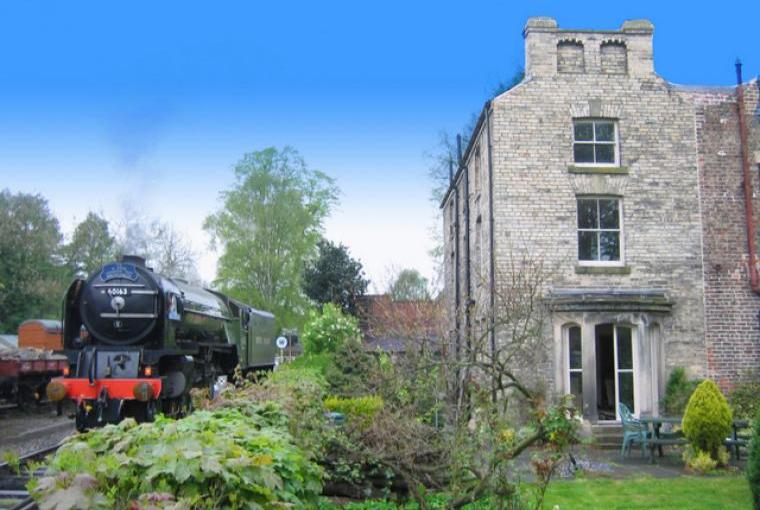 High Mill House from garden with Tornado and NYMR