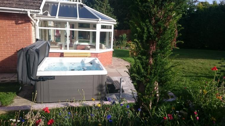 The hot tub in the secluded garden