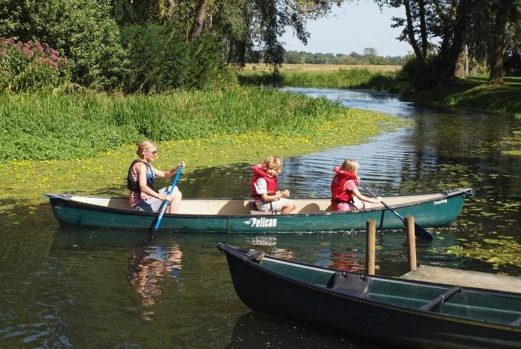 Explore the tranquil river by canoe from the garden