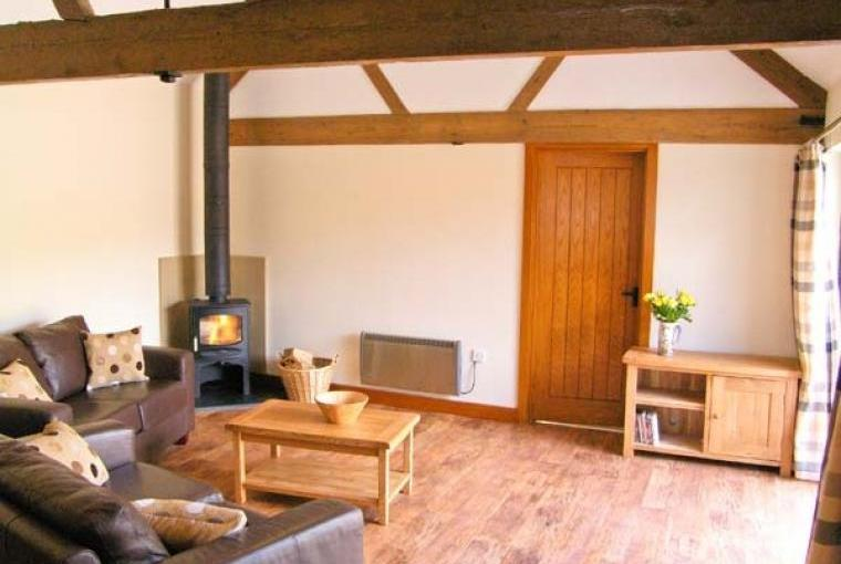 Lounge with beams and woodburner