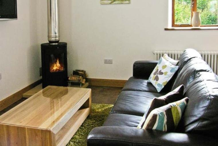 Comfy sofa with woodburner